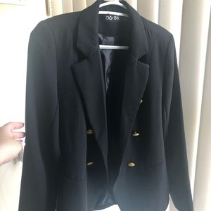 Black jacket with gold buttons and shoulder pads